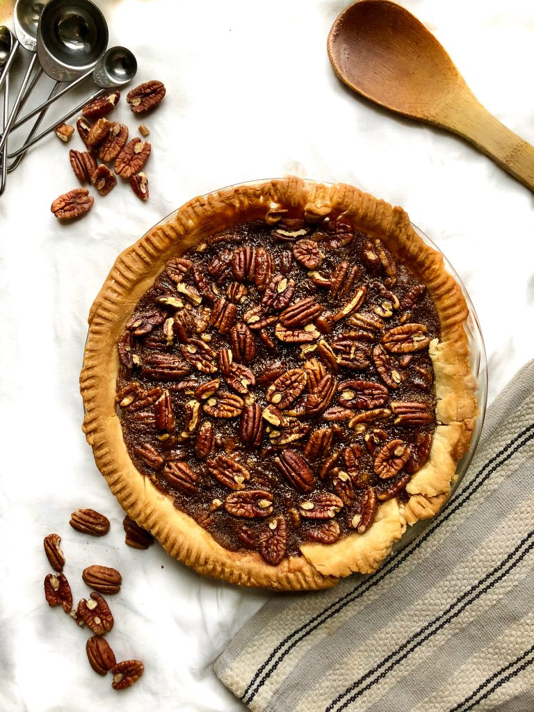 Pecan Pie that's made with just 8 ingredients in under an hour! Delicious and simple, totally vegan.
