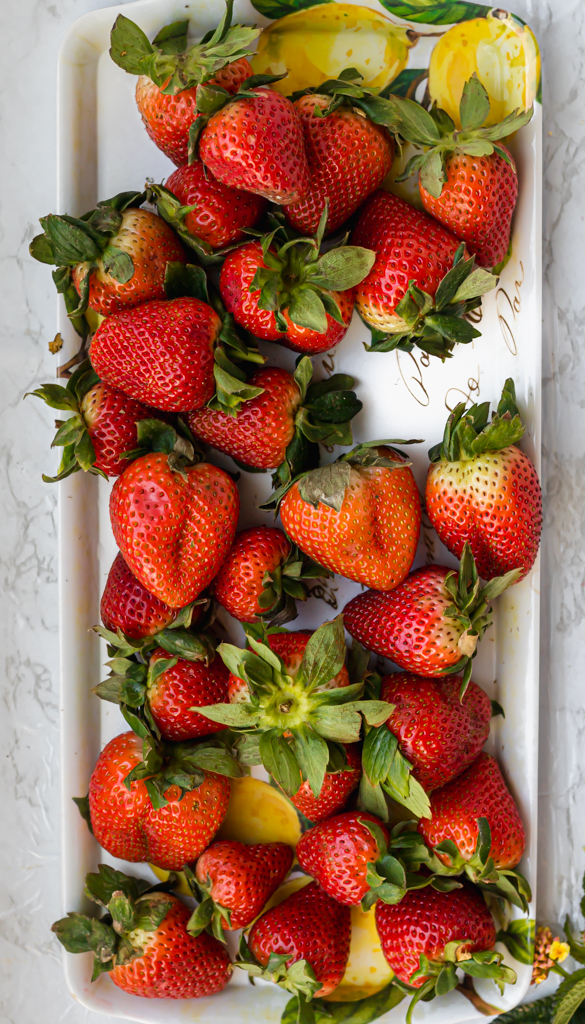 rectangular plate filled with bright red strawberries