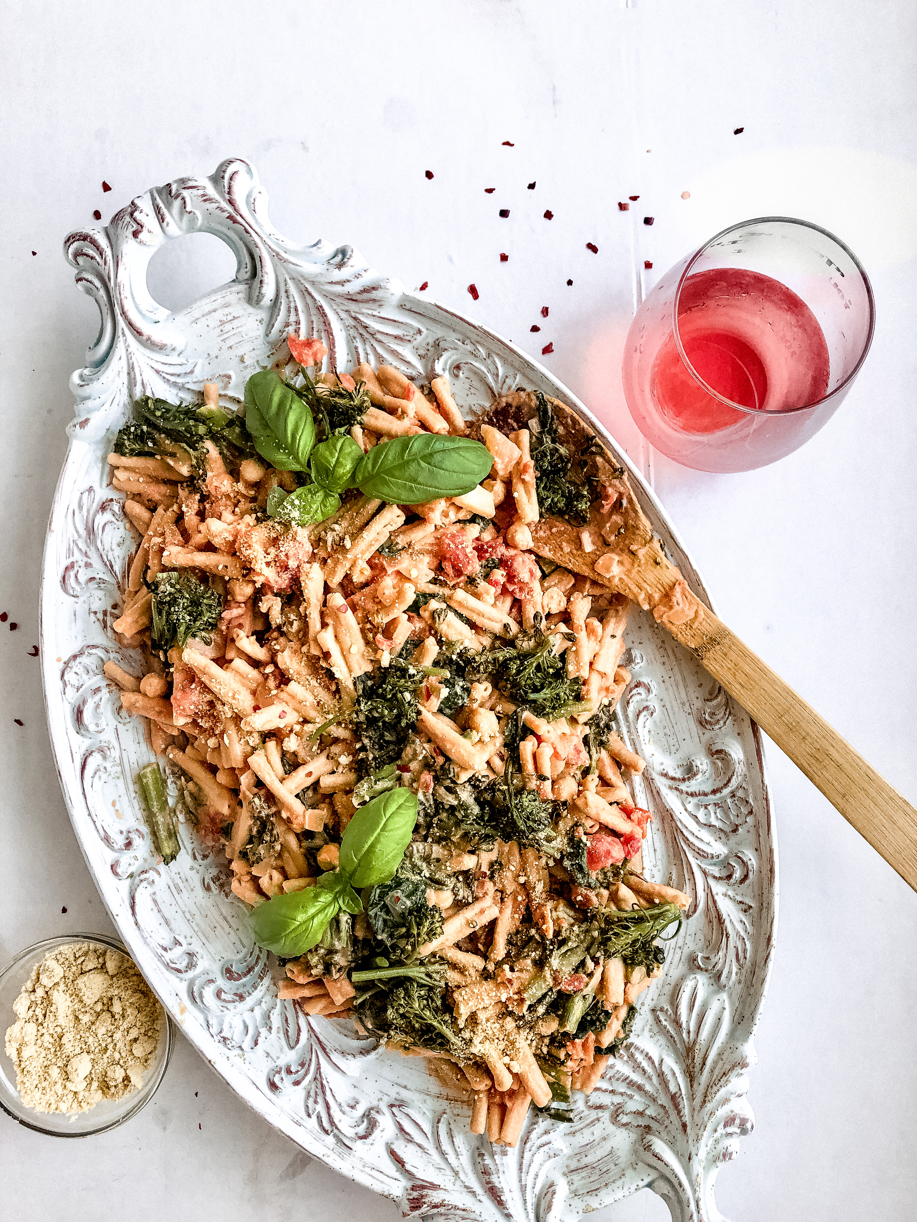 pasta with pink cream sauce, wine