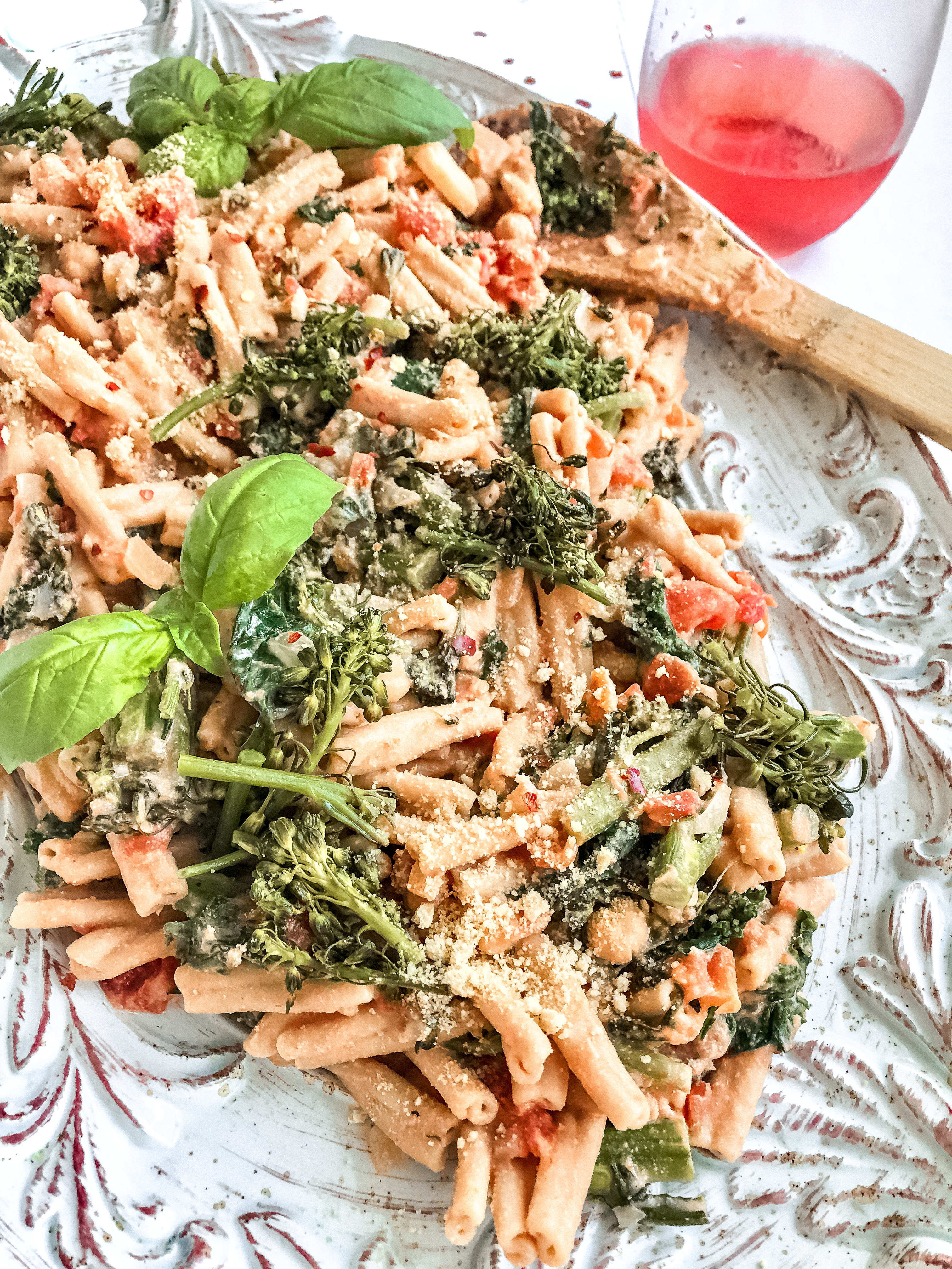pasta with pink cream sauce, wine, basil