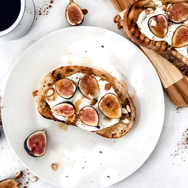 toast on white plate with cinnamon
