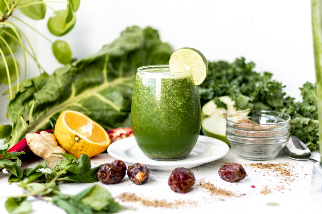 table of green smoothie with vegetables