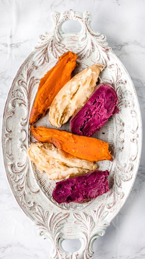 six sweet potato halves on a white dish cooked in the instant pot