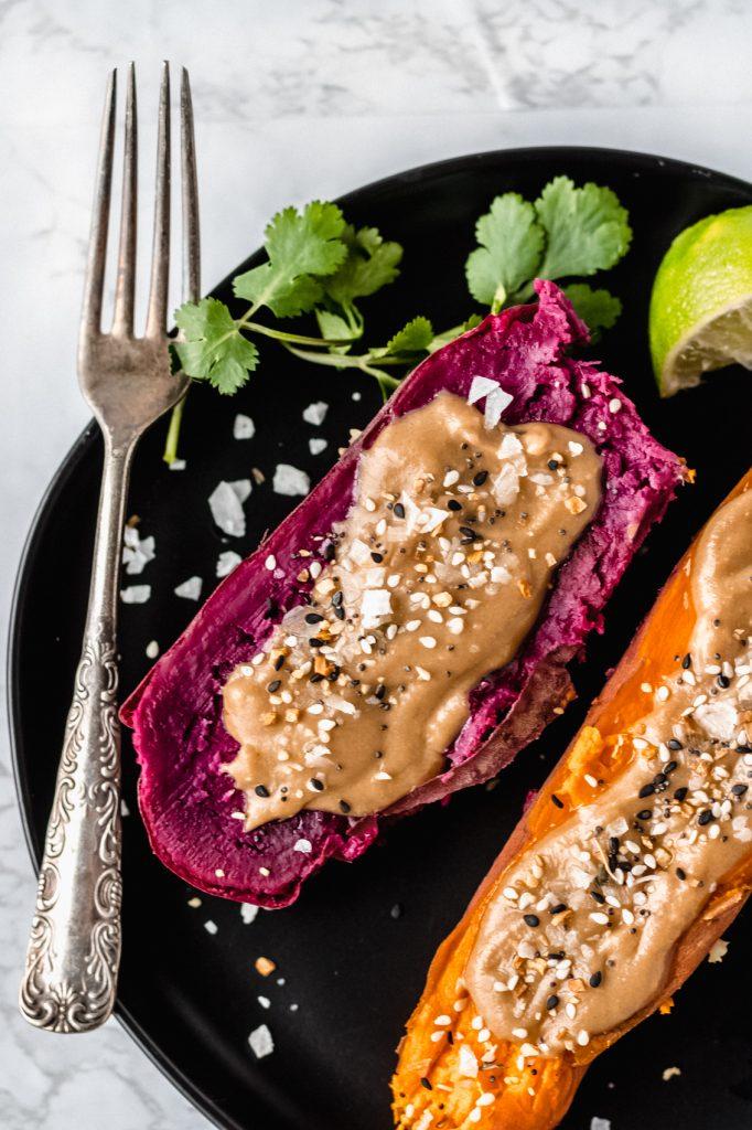 purple instant pot sweet potato with tahini butter on balack plate