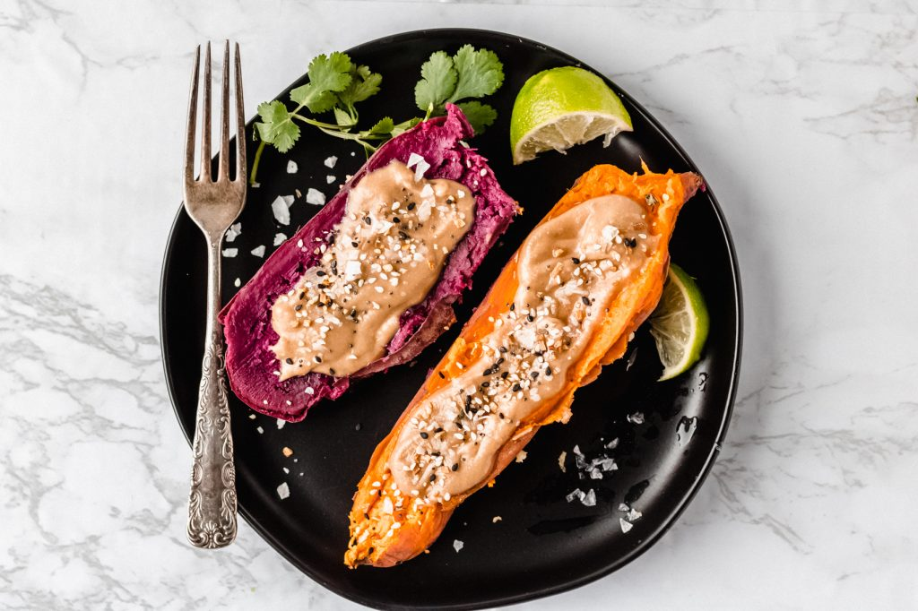 one purple and one orange sweet potato with tahini butter