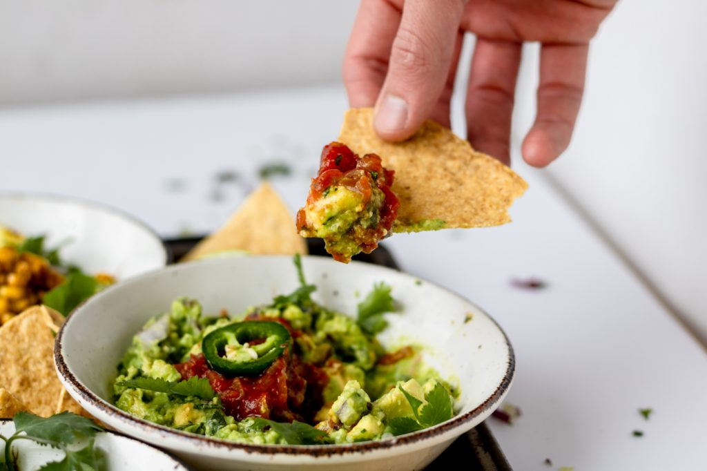 classic guacamole with a chip