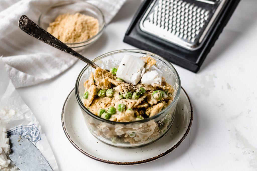 bowl of cacio e pepe pasta with cheese grater