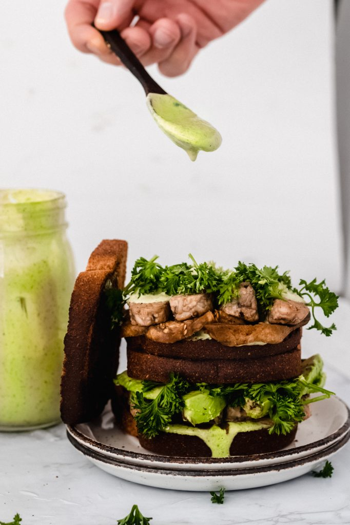 tempeh BLT with green tahini sauec