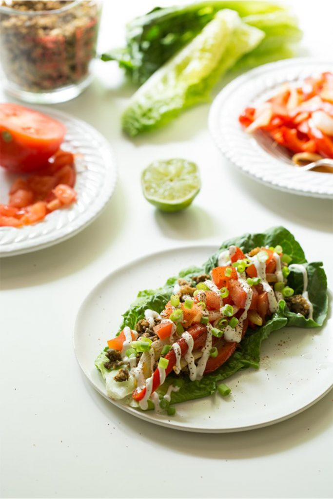 white plate with romaine lettuce leaf with pico