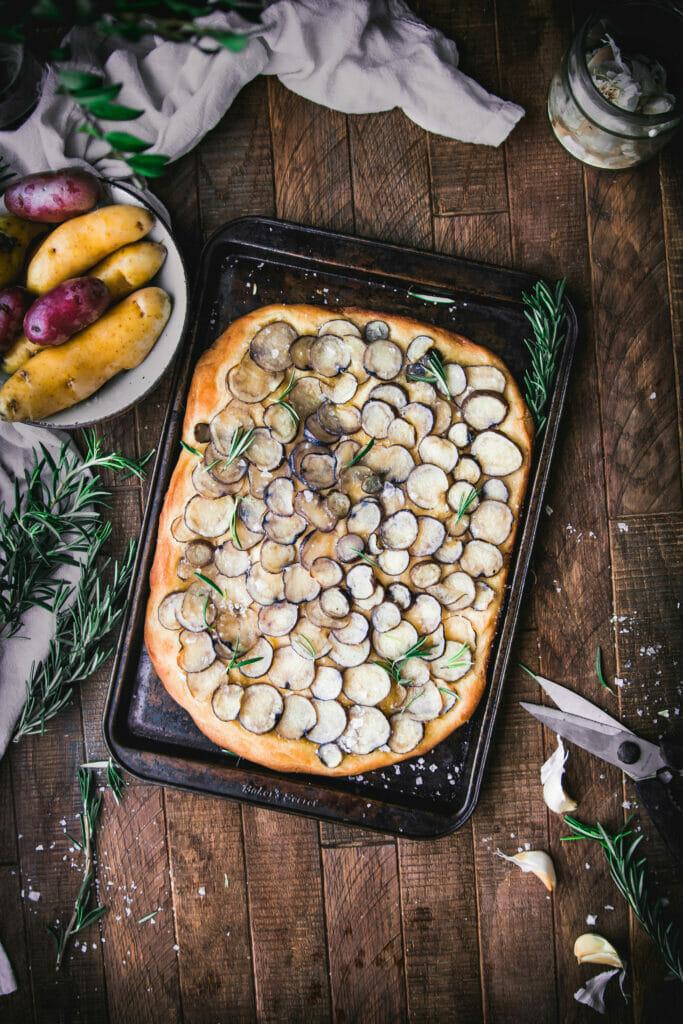 overhead shot of rosemary potato focaccia on a sheet tray