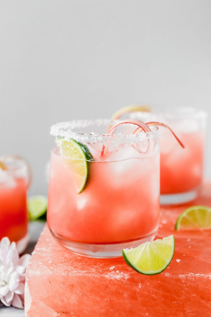 side view of pink margarita with lime
