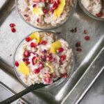 close up shot of vegan sushi rice pudding with pomegranate and rose petals