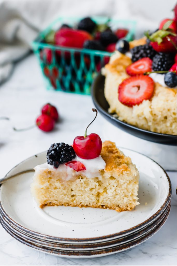 slice of olive oil cake with berries on top