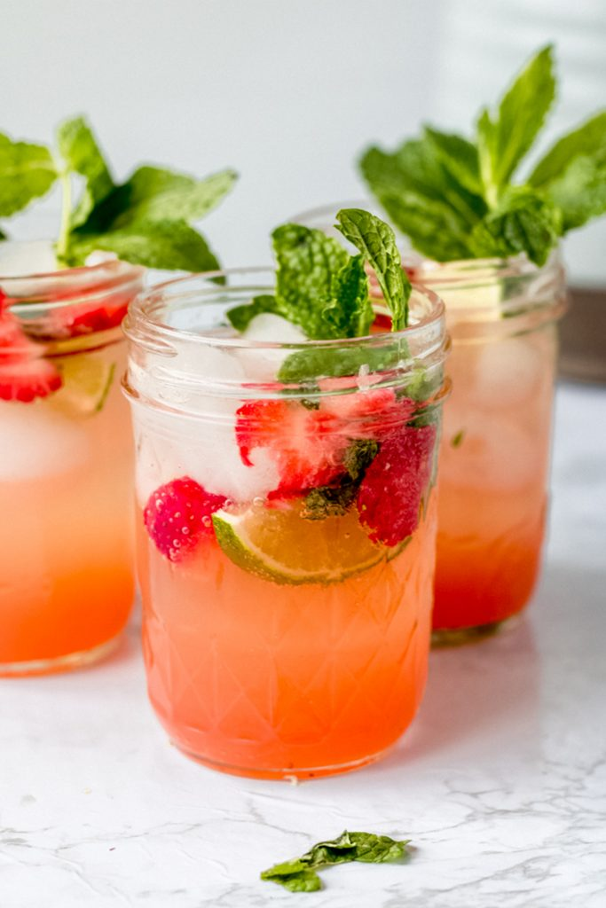 three glasses of strawberry limeade