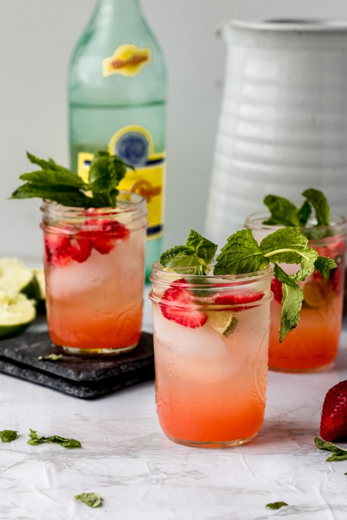 table of cocktails with garnishes of mint