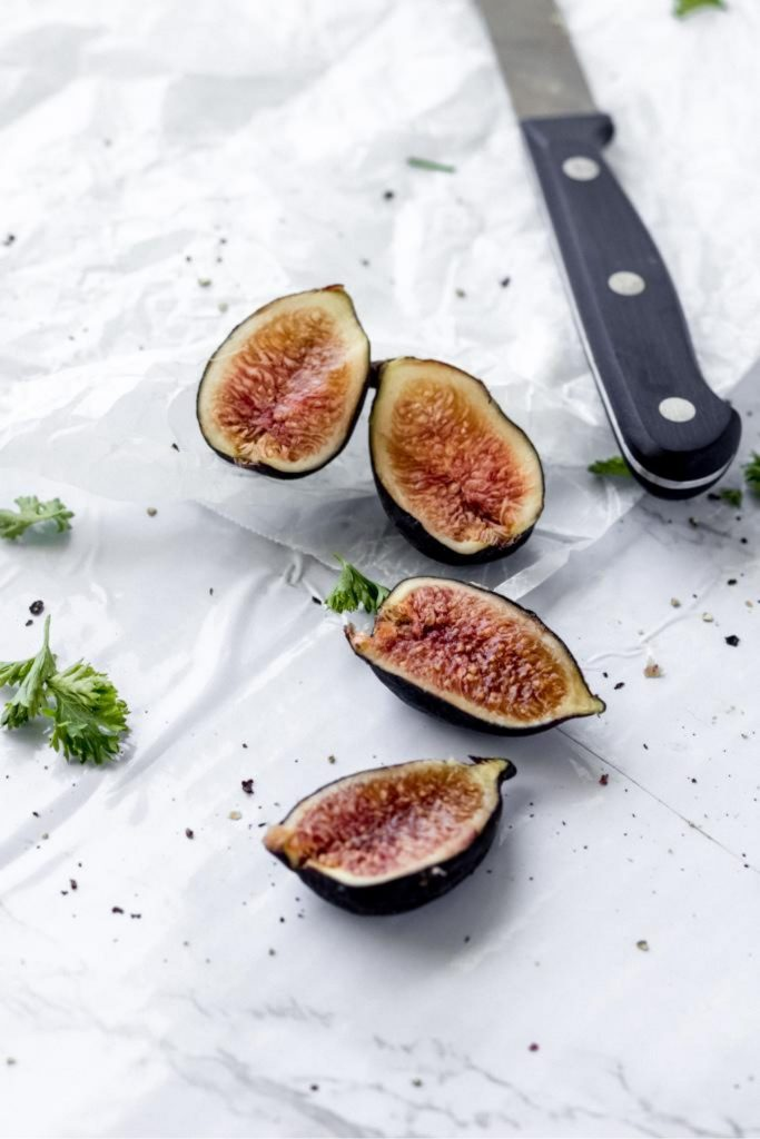sliced fresh figs on a marble board