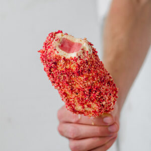 frozen strawberry shortcake bar held in a hand