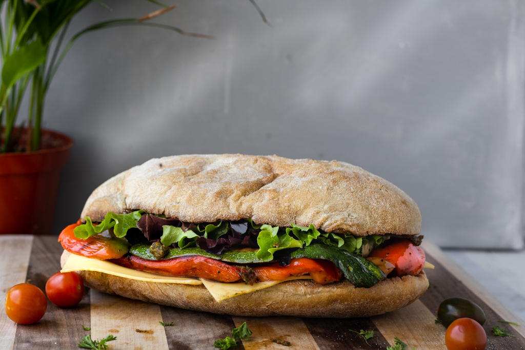 vegan veggie sub on a wooden board