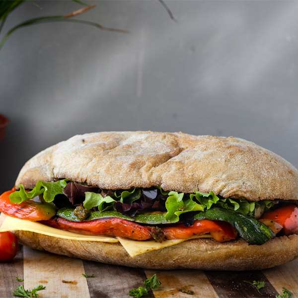 vegan veggie sub on a wooden board