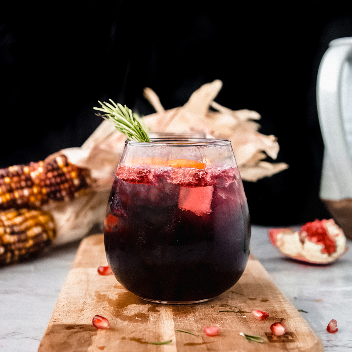 glass of red sangria on a wooden board