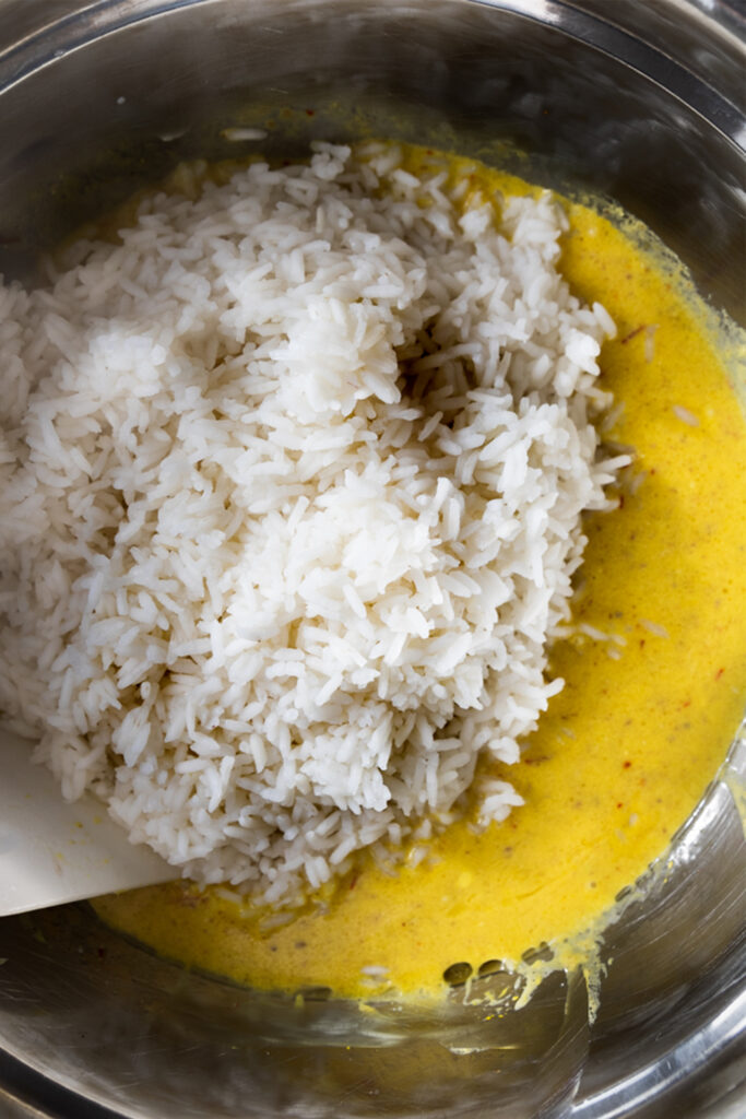 overhead shot of white basmati rice in a yellow saffron mixture
