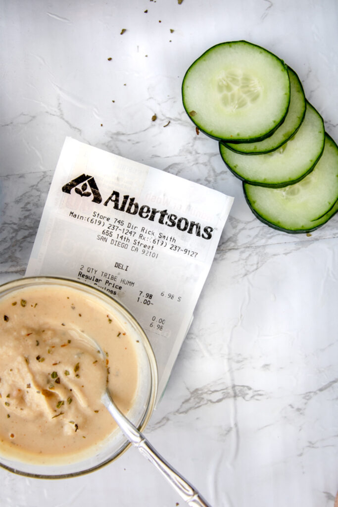 albertsons shopping receipt next to come cucumber sliced