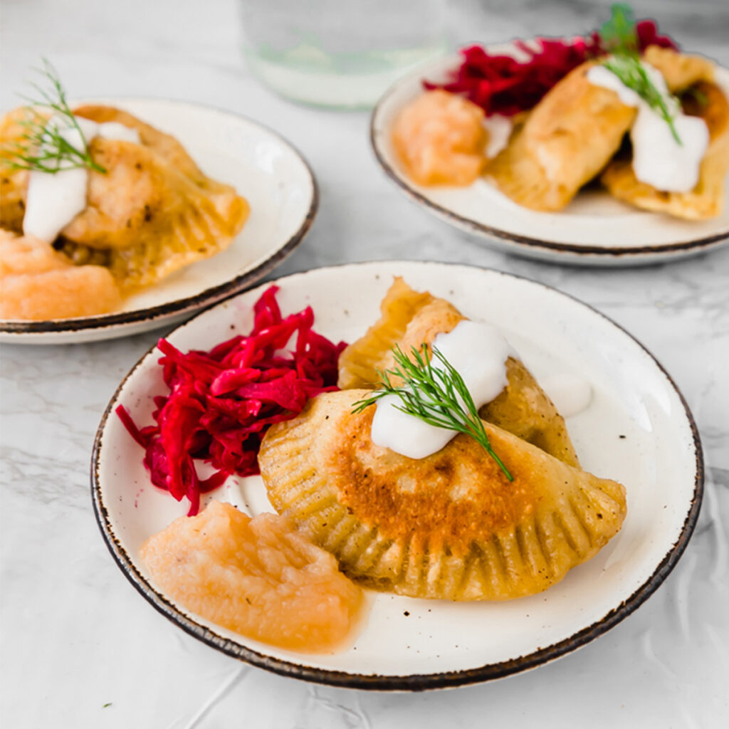 plate of vegan pierogi next to beet kraut