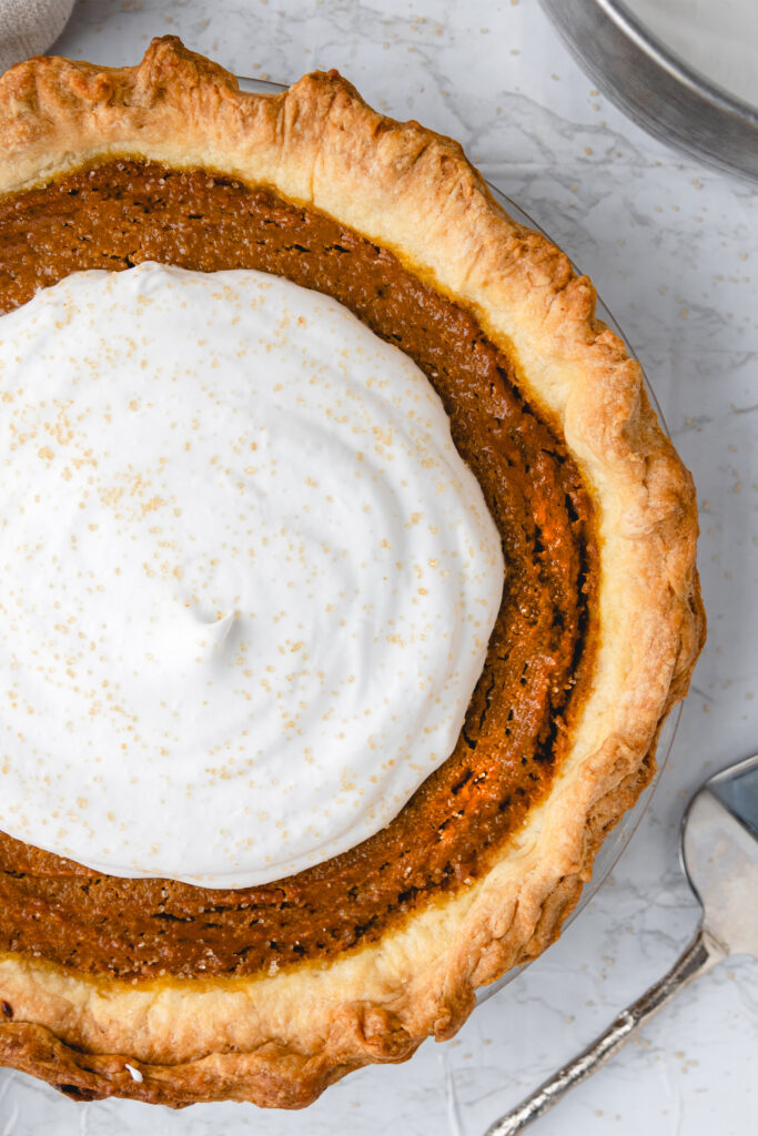 vegan pumpkin pie with dairy free whipped cream made with coconut cream
