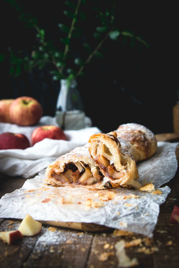 side view of two slices of puff pastry apple strudel