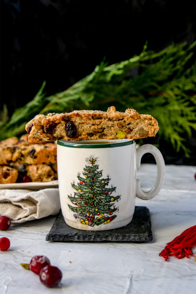 vegan biscotti sitting on top of a white cup of coffee