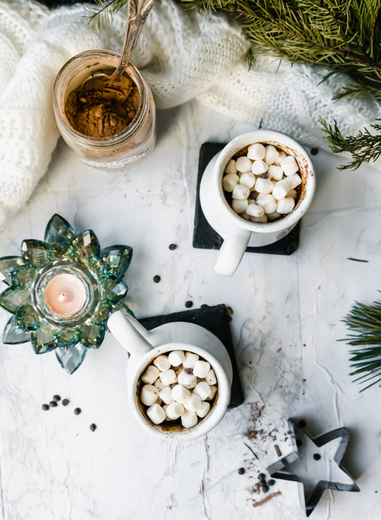 overhead shot of two mugs of dairy-free hot cocoa