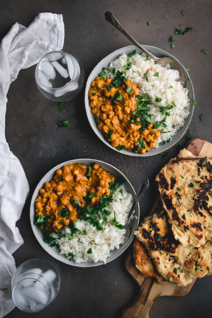 two bowls of vegan butter chickpeas