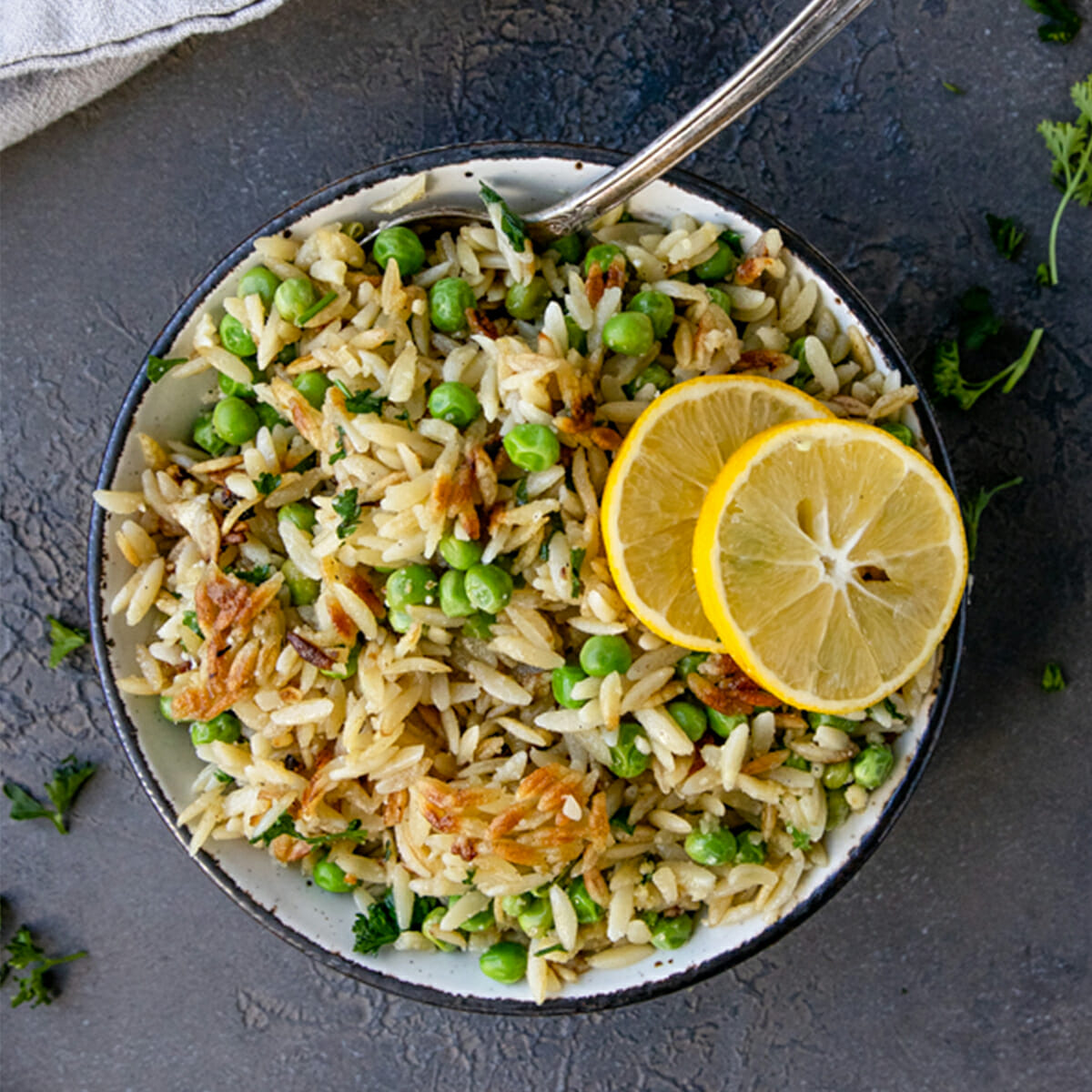 close up of crispy orzo with garlic butter on grey table