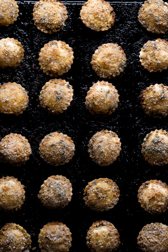 sheet tray of multiple crispy ravioli
