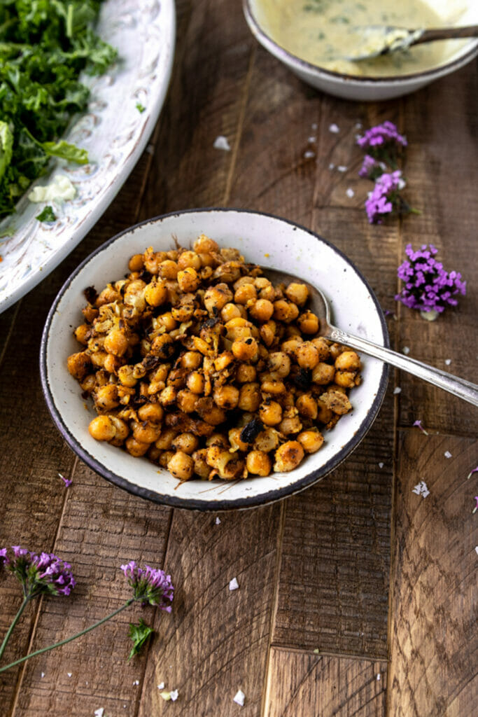 bowl of crispy chickpeas with silver spoon