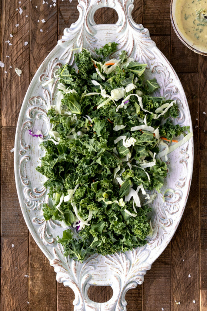 plate of kale and cabbage on wood board