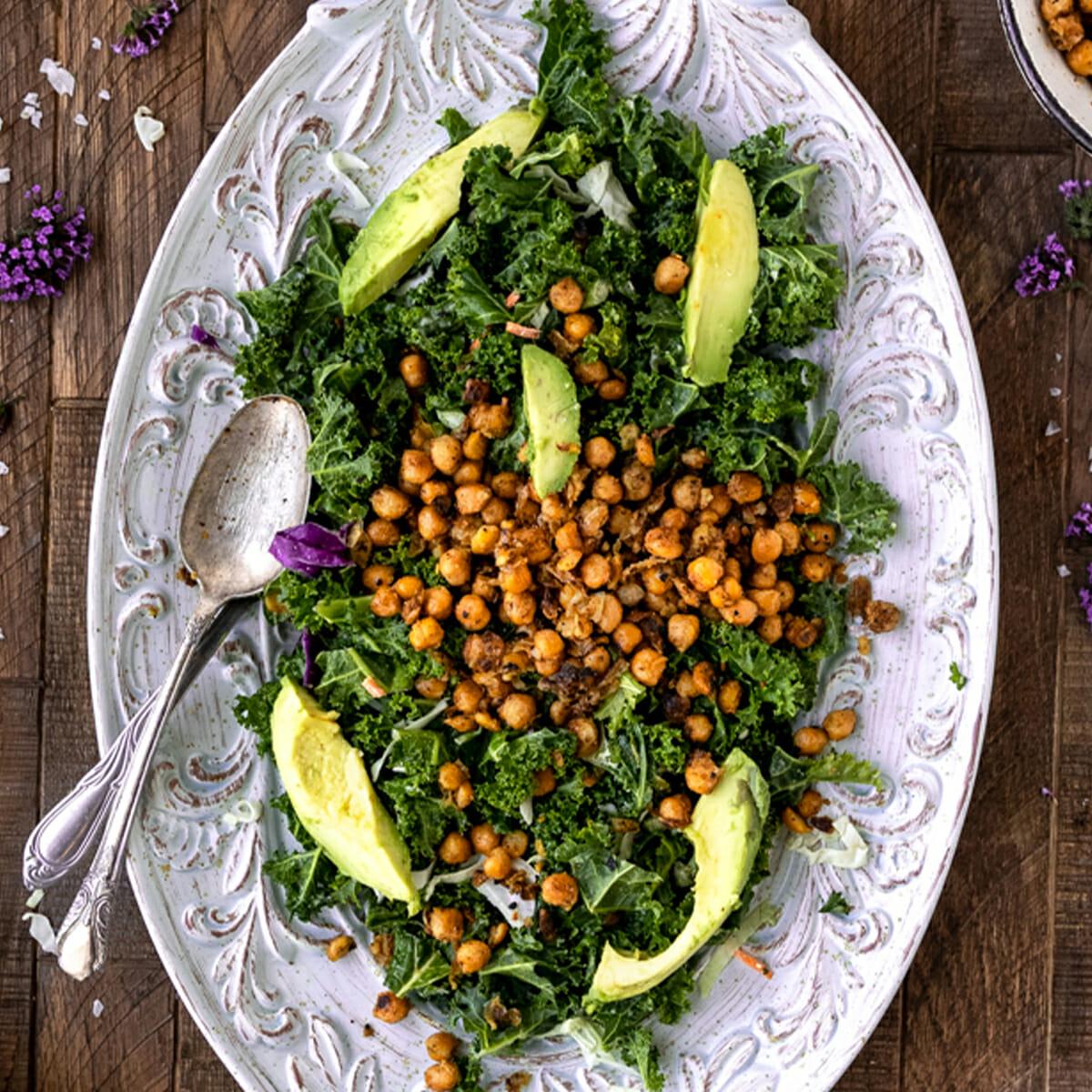 overhead shot of kale caesar salad with crispy chickpeas