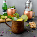 three extra gingery moscow mules garnished with mint and limes