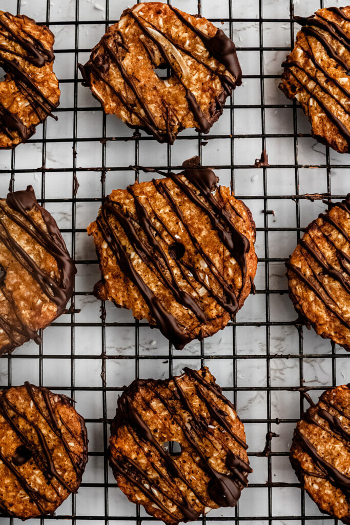 close up overhead shot of vegan samoas girl scout cookies on a wire rack