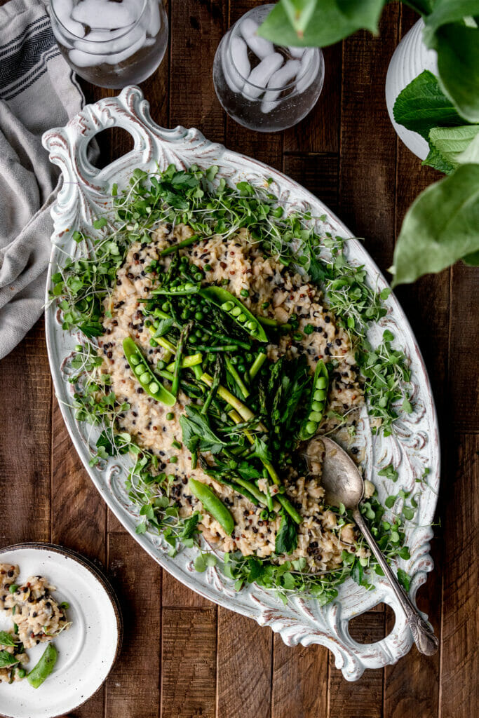 overhead shot of asparagus barley risotto and a wooden table