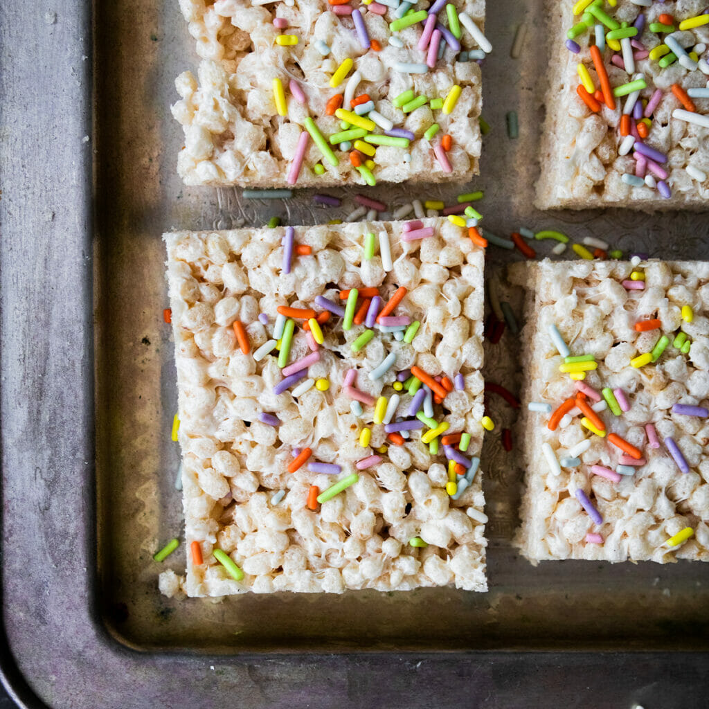 close up of vegna brown butter rice krispie with rainbow spirinkles