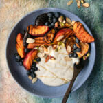 overhead shot of grilled peach yogurt bowls on next to chopped nuts