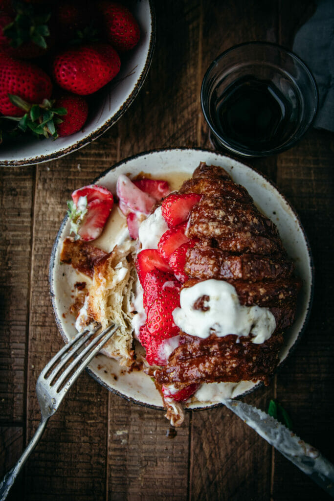 overhead shot of cinnamon crunch croissant french toast with a fork