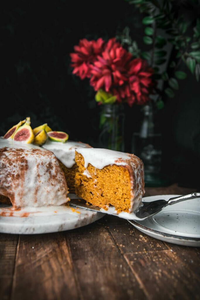 slice being taken out of a pumpkin cake