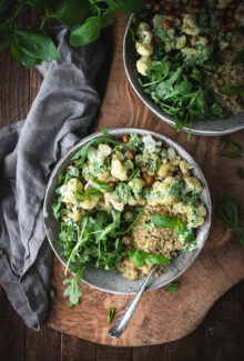 ovehead shot of cauliflower quinoa bowl with arugula