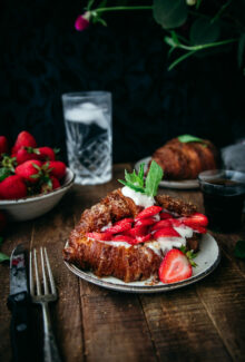 crispy golden baked croissant with strawberries and mint