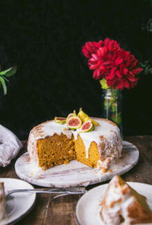 vegan pumpkin cake on a tray topped with brown butter frosting
