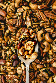 rosemary spiced nuts in a silver spoon