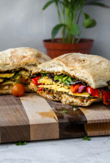 grilled veggie party sub on a wooden board