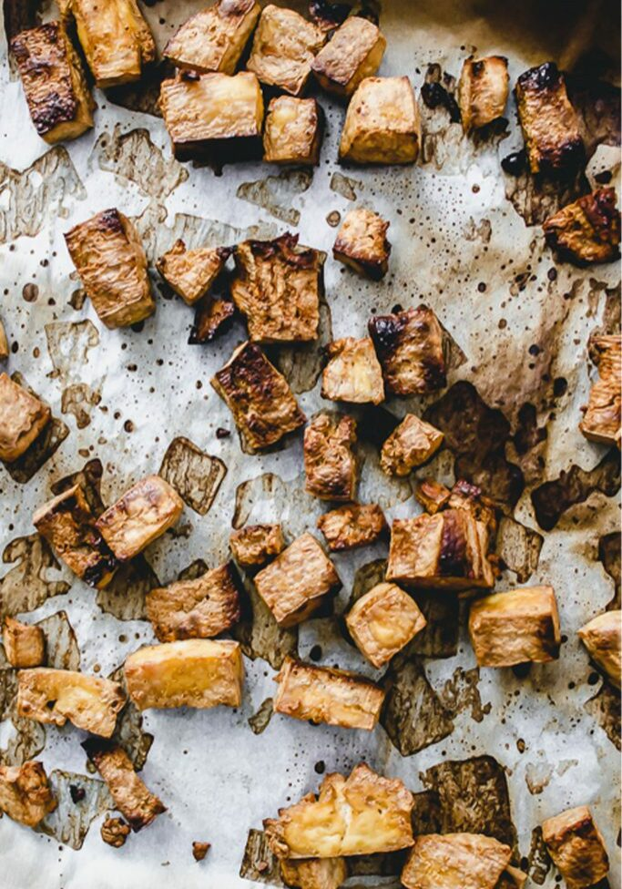 tray of broiled tofu on parchment